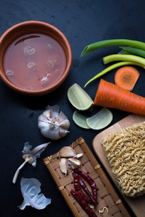 Overhead view of soup ingredients with instant noodles on tableの写真素材 [FYI03740391]
