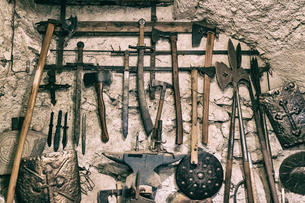 Close-up of various ancient tools hanged on old wallの写真素材 [FYI03746933]