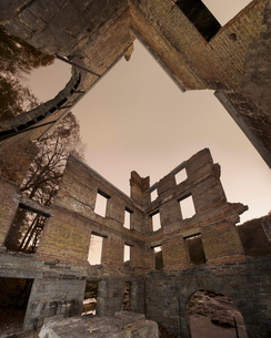 Low angle view of abandoned damaged mill at Sweetwater Creek State Park against Clear Skyの写真素材 [FYI03747971]