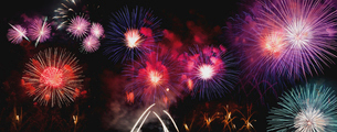 Panoramic view of colorful firework display against sky at nightの写真素材 [FYI03749276]