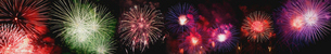 Low angle view of colorful firework display exploding against sky at nightの写真素材 [FYI03749287]