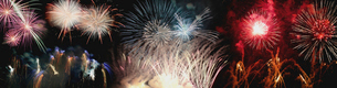 Low angle view of colorful firework display against sky at nightの写真素材 [FYI03749288]