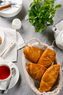High angle view of buns with tea served on tableの写真素材 [FYI03749629]