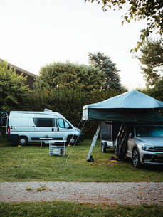 Motor homes parked on field against clear sky in forestの写真素材 [FYI03750119]