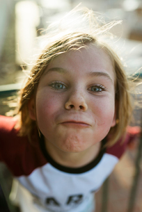 High angle portrait of girl making face while standing outdoorsの写真素材 [FYI03750179]