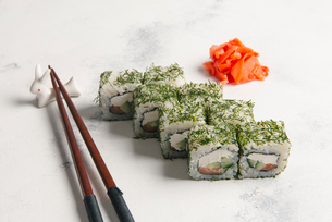 High angle view of sushi rolls with chopsticks and salmons served on tableの写真素材 [FYI03750430]
