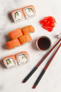 Overhead view of sushi rolls with dip and chopsticks served on tableの写真素材 [FYI03750434]