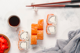 Overhead view of sushi rolls with dip and chopsticks served on tableの写真素材 [FYI03750443]