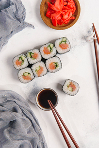 Overhead view of sushi rolls with dip and chopsticks arranged on tableの写真素材 [FYI03750445]
