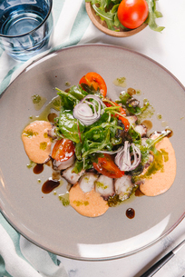 High angle view of salad with octopus served in plate on tableの写真素材 [FYI03750461]