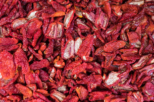 High angle view of dry red chili peppers for sale at marketの写真素材 [FYI03751251]
