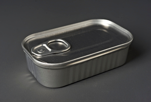 Close-up of closed sliver tin container over gray backgroundの写真素材 [FYI03751273]