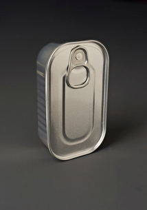 Close-up of closed tin container over gray backgroundの写真素材 [FYI03751275]