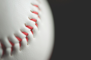 Macro shot of baseball ball against black backgroundの写真素材 [FYI03751614]