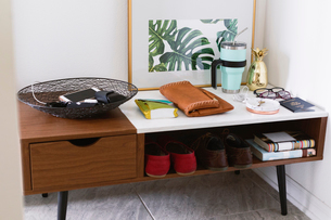 High angle view of various objects on cabinet at homeの写真素材 [FYI03752705]