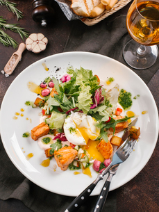 High angle view of salad with poached egg and salmon in plate on tableの写真素材 [FYI03752976]