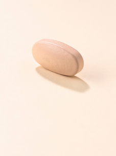 High angle view of medicine on beige backgroundの写真素材 [FYI03754187]