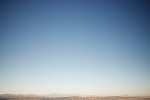 Tranquil view of landscape against clear blue skyの写真素材 [FYI03755761]