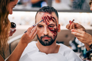 Man with makeup on his face with wounds and blood.の写真素材 [FYI03755885]