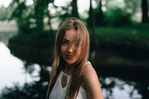 girl in the forest near the lakeの写真素材 [FYI03757434]