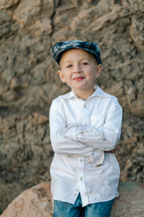 Portrait of smiling cute boy with dirty white shirtの写真素材 [FYI03757613]