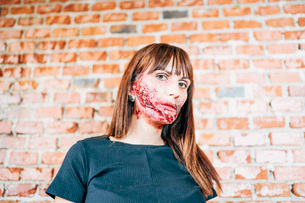 Woman with her face painted with terror wounds.の写真素材 [FYI03757786]