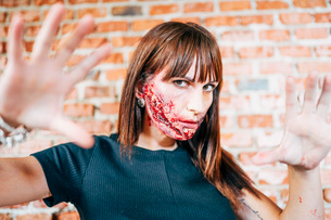 Woman with her face painted with terror wounds.の写真素材 [FYI03757787]