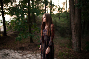 Caucasian girl stands in the forestの写真素材 [FYI03757840]