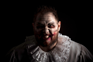 Portrait of a Scary Evil Clown.  Studio shot with horrible face artの写真素材 [FYI03758638]