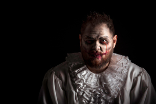 Portrait of a Scary Evil Clown.  Studio shot with horrible face artの写真素材 [FYI03758642]