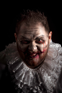 Portrait of a Scary Evil Clown.  Studio shot with horrible face artの写真素材 [FYI03758644]
