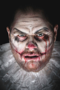 Portrait of a Scary Evil Clown.  Studio shot with horrible face artの写真素材 [FYI03758645]
