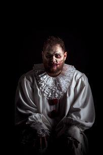 Portrait of a Scary Evil Clown.  Studio shot with horrible face artの写真素材 [FYI03758652]