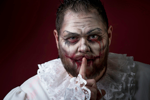 Portrait of a Scary Evil Clown.  Studio shot with horrible face artの写真素材 [FYI03758654]