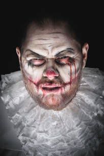 Portrait of a Scary Evil Clown.  Studio shot with horrible face artの写真素材 [FYI03758655]
