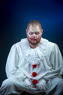 Portrait of a Scary Evil Clown.  Studio shot with horrible face artの写真素材 [FYI03758657]