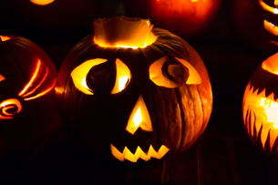 Halloween Pumpkin Carved into a Wide Eyed Silly Jack-O-Lanternの写真素材 [FYI03758939]