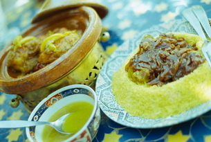 Traditional food of chicken tagine, and lamb with cous cous, Marrakechの写真素材 [FYI03761101]