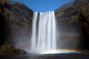 Skogafoss waterfall with double rainbow, South Iceland, Icelandの写真素材 [FYI03761453]
