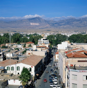 Street and rooftops of Turkish Cypriot North Nicosia with Kyrenia mountains in distance, taken fromの写真素材 [FYI03761860]