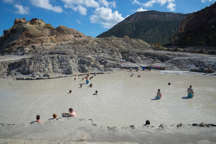 Bathers enjoying the therapeutic benefits of the volcanic mud in the hot spring pool, Vulcano Islandの写真素材 [FYI03765569]