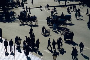 Pedestrians and horse-drawn carriages in a square, Marrakechの写真素材 [FYI03766101]