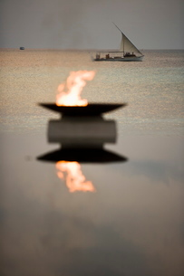 Flame and Boat, Maldivesの写真素材 [FYI03766520]