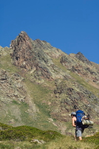 Hiker on climbing trail in hiking area of Pic de Coma Pedrosa, Andorra's highest mountain, Parish ofの写真素材 [FYI03767259]