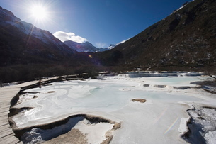 Colourful pools of calcite deposit frozen at Huanglong National Park, Sichuan Provinceの写真素材 [FYI03767521]