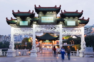 A Chinese style gate illuminated in Guiyang city, Guizhou Provinceの写真素材 [FYI03767526]