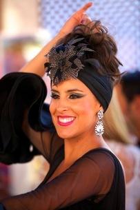 Flamenco dancer in traditional dress, Annual Horse Fair, Jerez de la Frontera, Cadiz Province, Andalの写真素材 [FYI03770812]