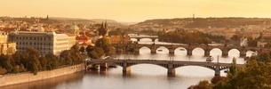 Bridges over the Vltava River including Charles Bridge, and the Old Town Bridge Tower at sunset, Praの写真素材 [FYI03771364]