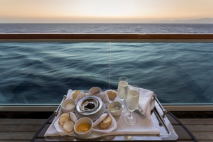 Chilled champagne and caviar with all the trimmings, al fresco on a luxury cruise ship, Red Sea, neaの写真素材 [FYI03772589]