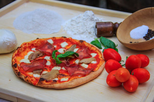 Set of typical Italian products of Bresaola of Valtellina, pizza with mushrooms, tomatoes from Sicilの写真素材 [FYI03773176]